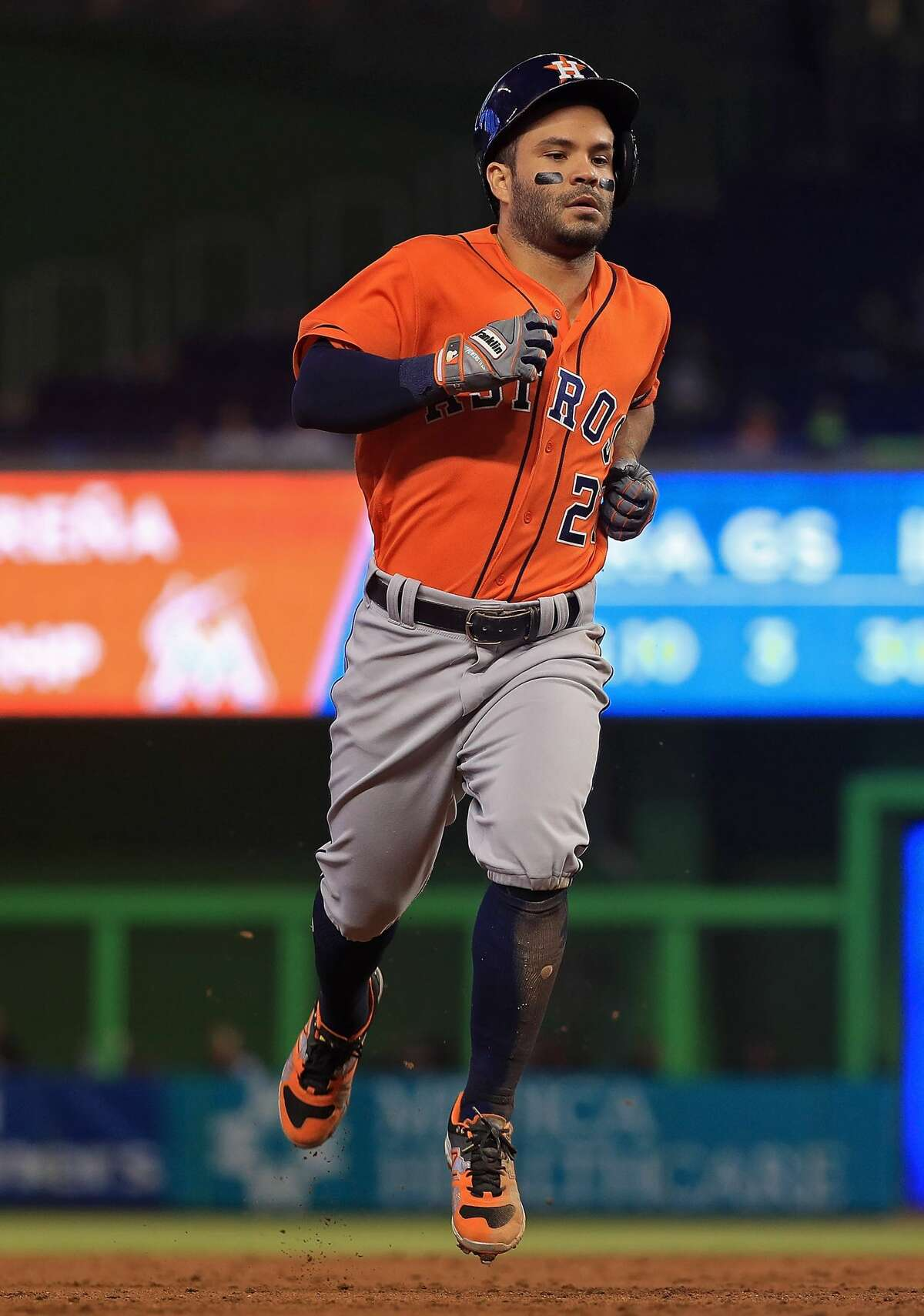 MIAMI, FL - MAY 17: Jose Altuve #27 of the Houston Astros hits a triple in the third inning during a game against the Miami Marlins at Marlins Park on May 17, 2017 in Miami, Florida. (Photo by Mike Ehrmann/Getty Images)