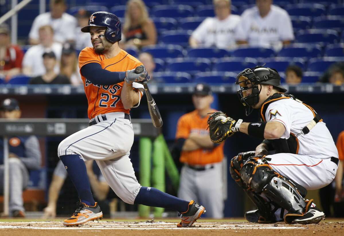 Houston Astros' Jose Altuve hits an RBI double scoring George Springer during the first inning of a baseball game against the Miami Marlins, Wednesday, May 17, 2017, in Miami. (AP Photo/Wilfredo Lee)