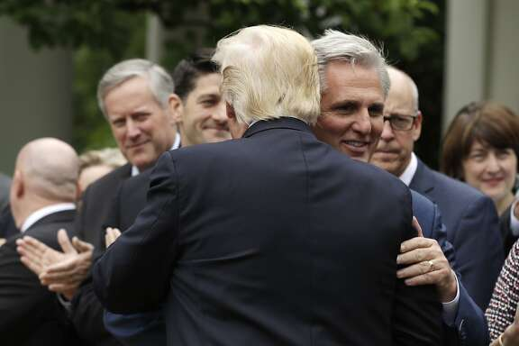 President Donald Trump hugs House MaJority Leader Kevin McCarthy of Calif. in the Rose Garden of the White House in Washington, Thursday, May 4, 2017, after the House pushed through a health care bill. (AP Photo/Evan Vucci)