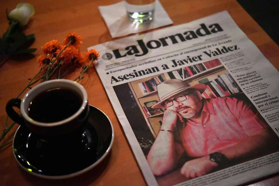 A makeshift altar for slain Mexican journalist Javier Valdez Cárdenas is seen at a cafe that had been frequented by Valdez in Culiacan, Sinaloa state, Mexico. Photo: YURI CORTEZ, AFP/Getty Images