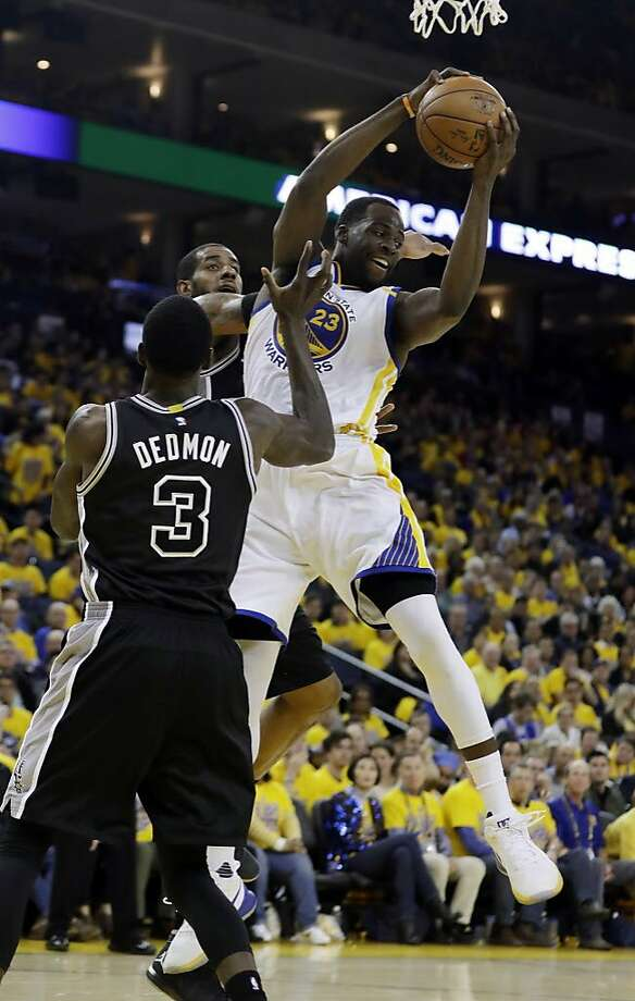 Golden State Warriors' Draymond Green (23) grabs a rebound against the San Antonio Spurs during the second half of Game 2 of the NBA basketball Western Conference finals, Tuesday, May 16, 2017, in Oakland, Calif. (AP Photo/Marcio Jose Sanchez) Photo: Marcio Jose Sanchez, Associated Press