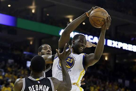 Golden State Warriors' Draymond Green (23) grabs a rebound against the San Antonio Spurs during the second half of Game 2 of the NBA basketball Western Conference finals, Tuesday, May 16, 2017, in Oakland, Calif. (AP Photo/Marcio Jose Sanchez)