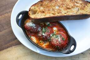 Meatballs--beef brisket and kurobuta pork shoulder, tomato sugo, buffalo mozzarella, and griddled country bread--at Contrada on Friday, May 12, 2017, in San Francisco, Calif.    	Contrada opened on Union Street within the last year.