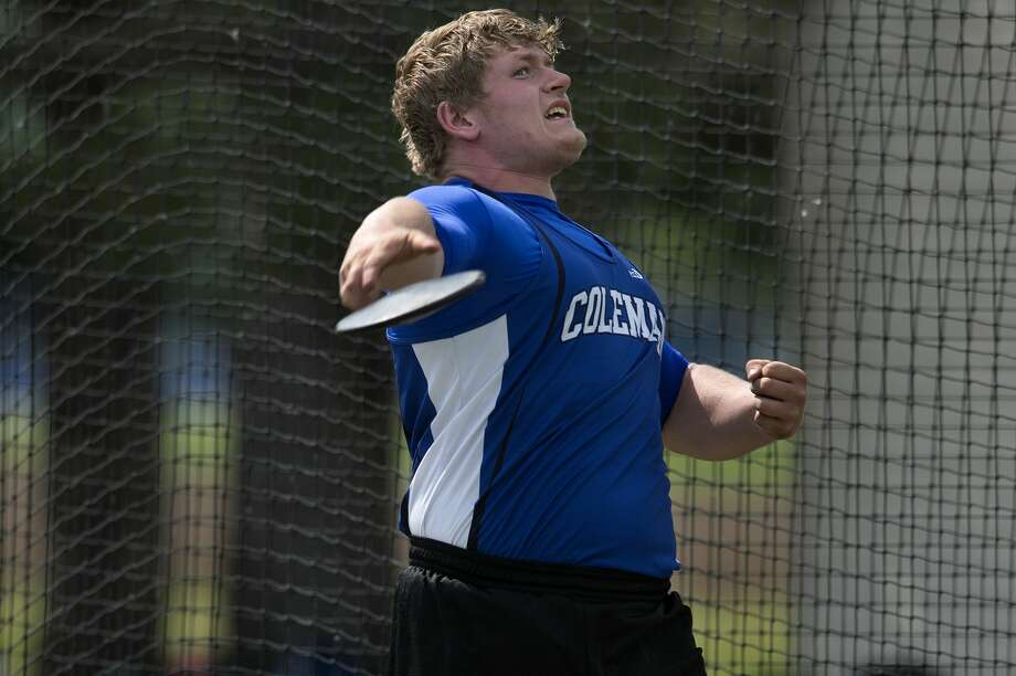 Coleman's Cody Finney releases the discus during a Wednesday afternoon track meet against Houghton Lake. Finney threw the discus 104.4 feet. Photo: Brittney Lohmiller/Midland Daily News/Brittney Lohmiller