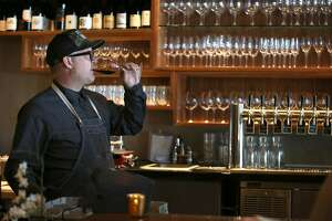 Chef Jason Tuley does a wine tasting from the sixteen spigots for the beers and wines on tap at Contrada on Friday, May 12, 2017, in San Francisco, Calif.  Contrada opened on Union Street within the last year.