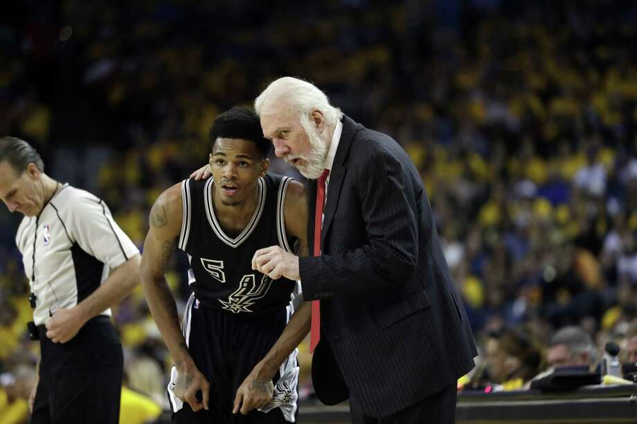 Gregg Popovich (right) talks to guard Dejounte Murray in the second half of a Western Conference Finals Game against the Golden State Warriors. On top of his NBA Summer League duties this offseason, the rising Spurs star will work out with teammate and MVP finalist Kawhi Leonard in San Diego. Photo: Marcio Jose Sanchez / Associated Press / Copyright 2017 The Associated Press. All rights reserved.