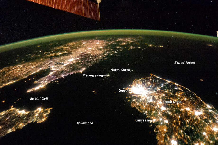 If not for labels, this image might appear to show a wide strait connecting the Sea of Japan and the Yellow Sea between China and South Korea. But looking closely, you can see that big dark area is just North Korea, apparently all but completely shut down at night. You can also make out the orange lights along the border of the demilitarized zone as light turns to dark in the image. Photo: NASA