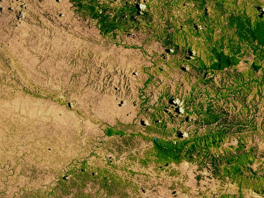 This is the border between the Dominican Republic, on the right, and Haiti on the left. The line that marks the shift from green to brown shows what happens when heavy deforestation hits one nation but not the other one. Photo: NASA