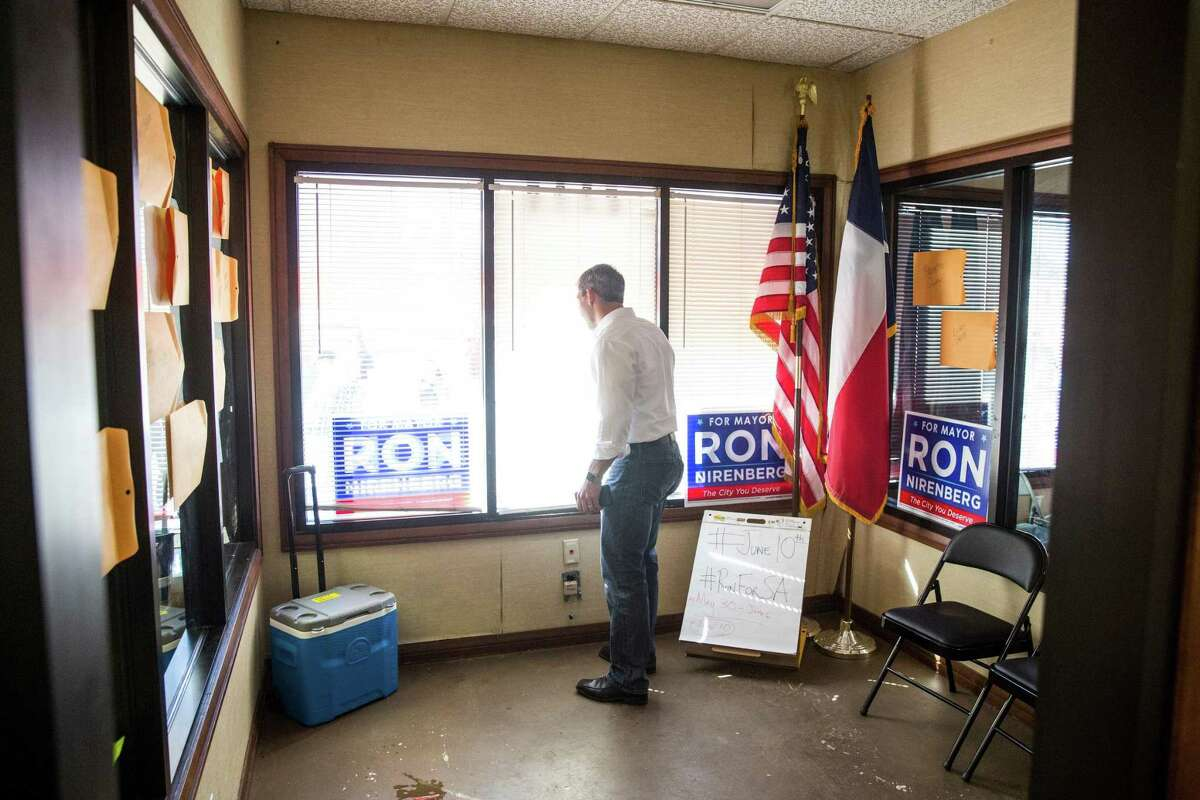 Mayoral candidate Ron Nirenberg talks on the phone with his son while looking out a window at his campaign headquarters in San Antonio, Texas on May 13, 2017. Ray Whitehouse / for the San Antonio Express-News