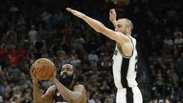 Spurs' Manu Ginobili (20) makes the block against Houston Rockets' James Harden (13) to end the game in Game 5 of the Western Conference semifinals at the AT&T Center on Tuesday, May 9, 2017. Spurs defeated the Rockets, 110-107. (Kin Man Hui/San Antonio Express-News)