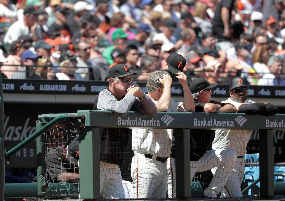 Manager Bruce Bochy (left) and his staff watch from the dugout, as the San Francisco Giants went on to lose to the Los Angeles Dodgers 6-1 in MLB action at AT&T Park in San Francisco, Ca. on Wednesday May 17, 2017. Photo: Michael Macor, The Chronicle