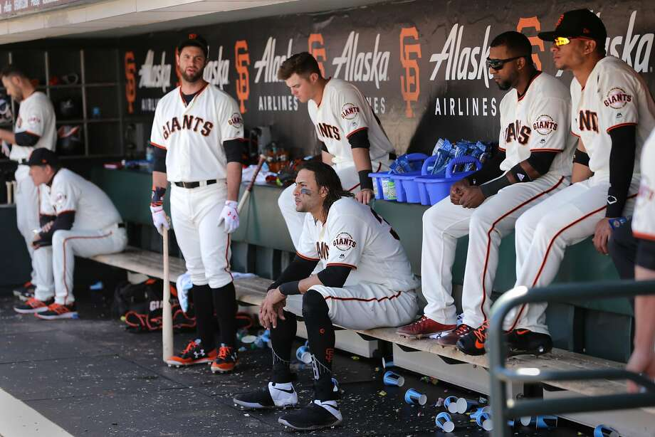 Brandon Belt (standing), Michael Morse (sitting on bench) and Joe Panik (behind Morse) are among the Giants deflated in the ninth inning of a loss Wednesday that ended San Francisco's five-game win streak. Photo: Michael Macor, The Chronicle