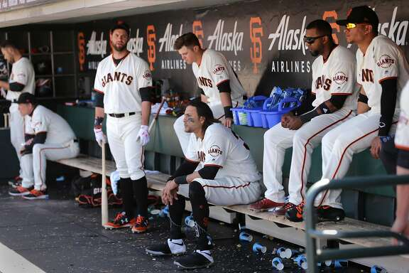 Brandon Belt, Michael Morse and Joe Panik, (center) in the dugout during the top of the 9th innning, as the San Francisco Giants went on to lose to the Los Angeles Dodgers 6-1 in MLB action at AT&T Park in San Francisco, Ca. on Wednesday May 17, 2017.