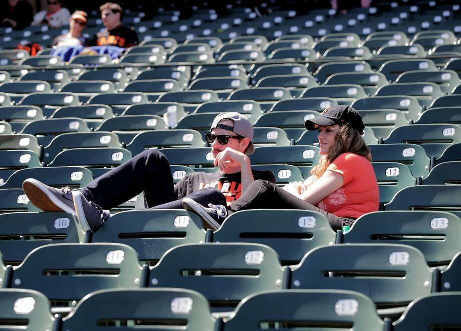 Fans Jason Linsteadt and Stephanie Wilkinson stuck around after  the San Francisco Giants lost to the Los Angeles Dodgers 6-1 in MLB action at AT&T Park in San Francisco, Ca. on Wednesday May 17, 2017. They said they still had a great time even after the giants lost the game. Photo: Michael Macor, The Chronicle