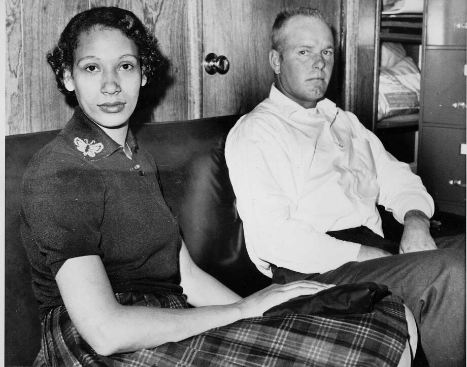 Richard P. Loving and his wife, Mildred, pose in this Jan. 26, 1965, file photograph. Residents of Caroline County, Va., the Lovings married in Washington, D.C., in 1958. Upon their return to Virginia, the interracial couple was convicted under the state's law that banned mixed marriages. They eventually won a U.S. Supreme Court decision in June 1967 that overturned laws prohibiting interracial unions. (AP Photo) Photo: AP