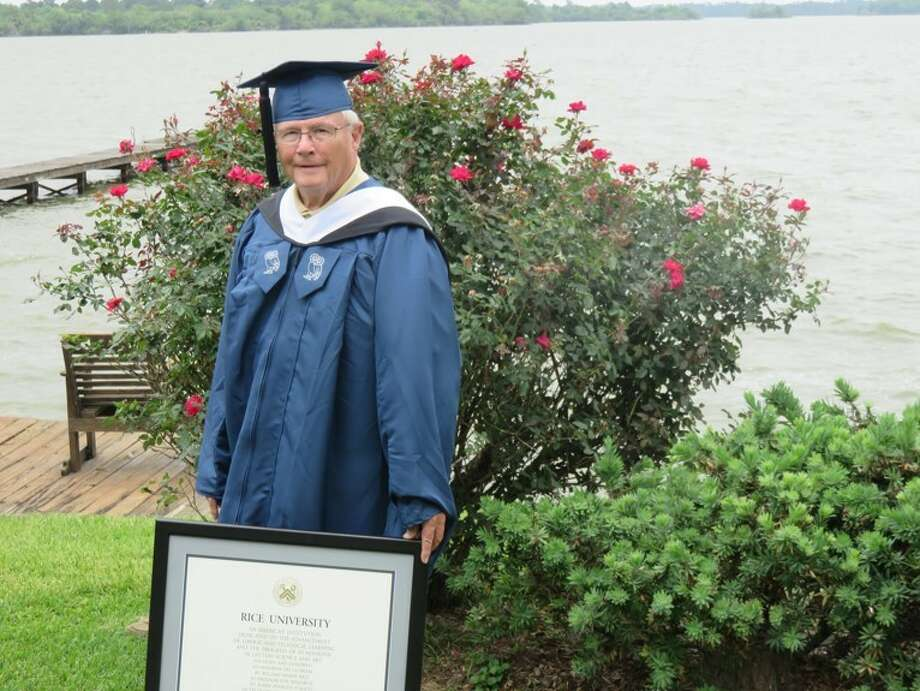 Father James M. Abernathey stands with his diploma after earning a Master of Liberal Studies degree from Rice University. Photo: Courtesy