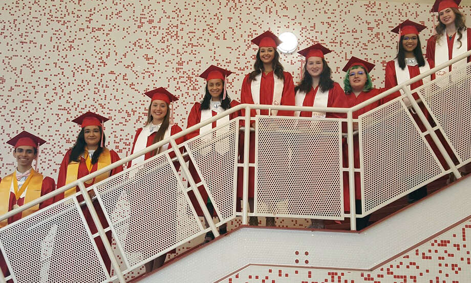 Crosby High School's top graduates for the class of 2017 pose in cap and gown at Crosby High School May 12. From left to right: Bryan Najera Demoraes, Maria Vaca, Carrie Butkiewicz, Alexis Bennett, Marley Hofmann, Ragen Runkle, Amber Dey, Jailene Polanco, Kailey Fuchs. Photo: Melanie Feuk