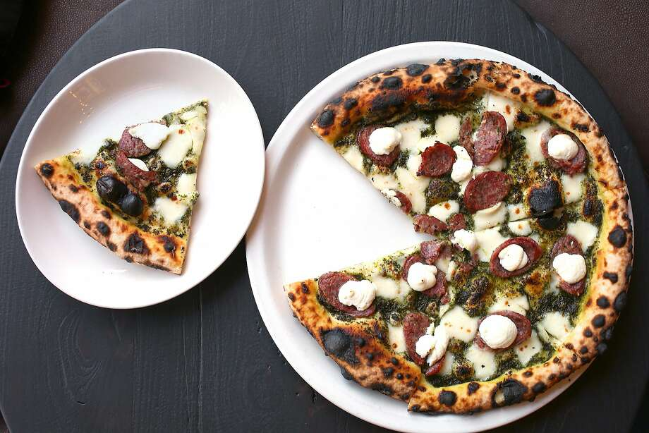 A pizza of house-made sausage, nettle pesto and fresh ricotta at Contrada in S.F. Photo: Liz Hafalia, The Chronicle