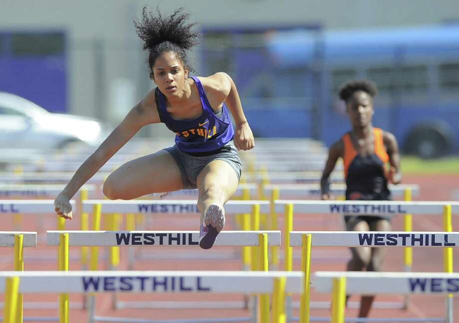 Westhill Yaciana Taveras complete in the girls 100 meter hurdles during a dual school track and field meet against Stamford at Westhill High School J. Walter Kennedy Athletic Complex in Stamford, Conn. on May 17, 2017. Taveras set a personal best record, winning the event with a time of 17.4 seconds. Photo: Matthew Brown / Hearst Connecticut Media / Stamford Advocate