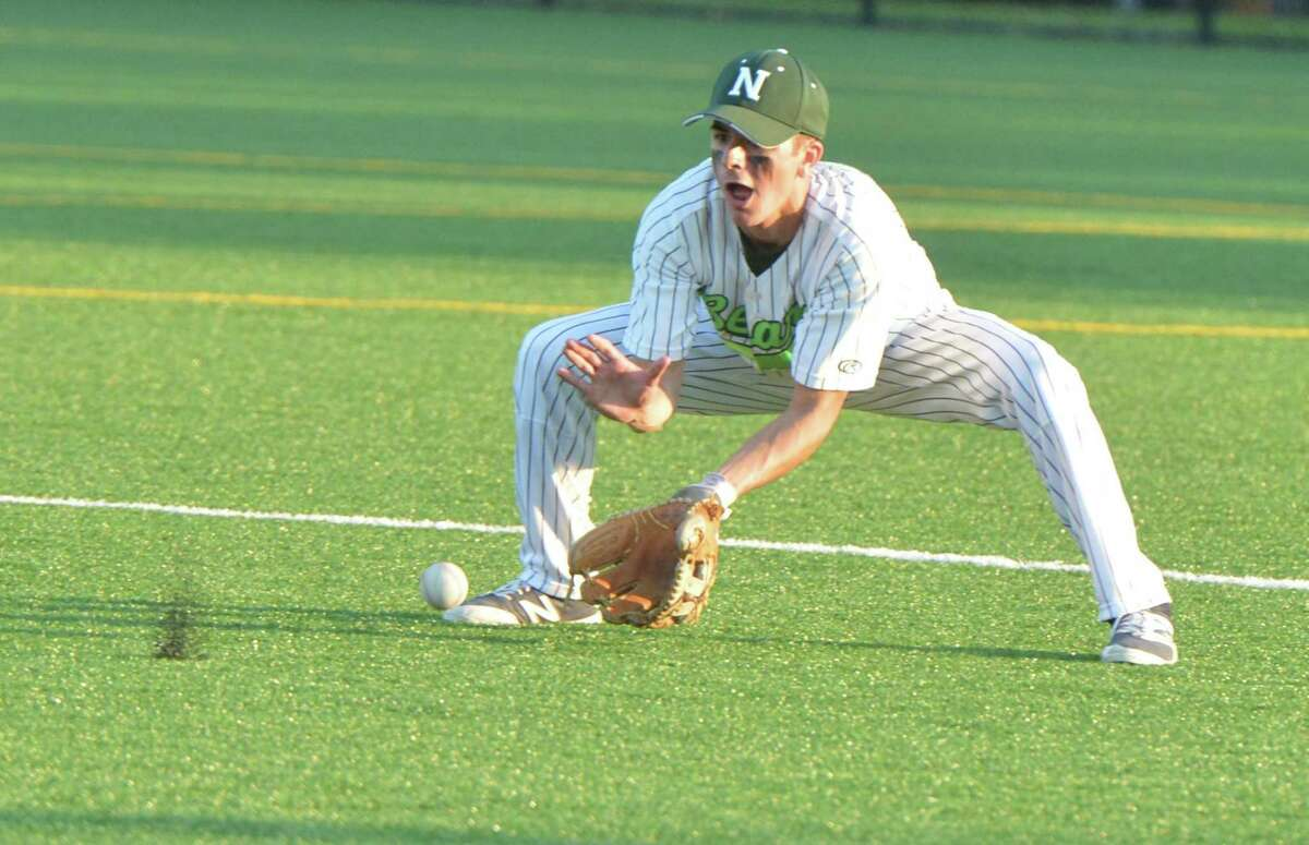 Norwalk High School's #2 Kyle Mossop grabs a ground ball during baseball action vs. Darien High on Wednesday May 17, 2017 in Norwalk Conn.