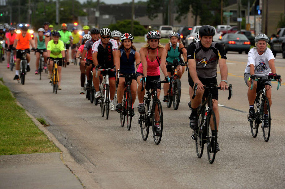 Cyclists ride down Major Drive during the Ride of Silence memorial ride on Wednesday evening. The annual ride takes place around the world in memory of cyclists who have been killed while riding their bikes.  Photo taken Wednesday 5/17/17 Ryan Pelham/The Enterprise Photo: Ryan Pelham / ©2017 The Beaumont Enterprise/Ryan Pelham