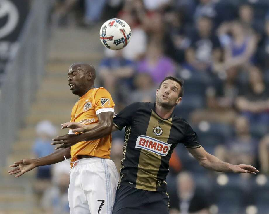 Philadelphia Union forward Chris Pontius, right, goes after the ball against Houston Dynamo midfielder DaMarcus Beasley during the first half of an MLS soccer match Wednesday, May 17, 2017, in Chester, Pa. (Yong Kim/The Philadelphia Inquirer via AP) Photo: YONG KIM/Associated Press