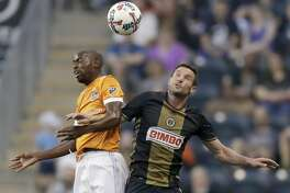 Philadelphia Union forward Chris Pontius, right, goes after the ball against Houston Dynamo midfielder DaMarcus Beasley during the first half of an MLS soccer match Wednesday, May 17, 2017, in Chester, Pa. (Yong Kim/The Philadelphia Inquirer via AP)