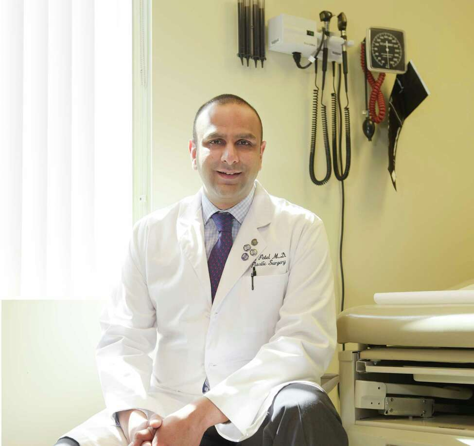 Doctor Ashit Patel, associate professor of plastic surgery with Albany Medical Center, poses in an examine room on Wednesday, April 12, 2017, in Albany, N.Y. (Paul Buckowski / Times Union)
