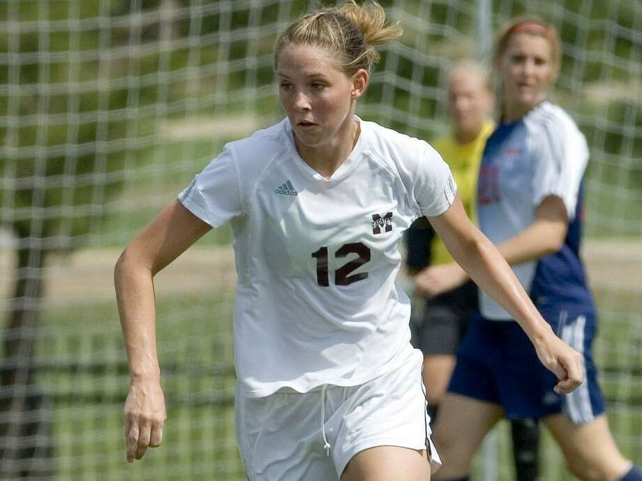 Treena Ferguson, who played at Mississippi St., says soccer helps her cope when her husband, a fighter pilot, is deployed. Photo: Courtesy Photo