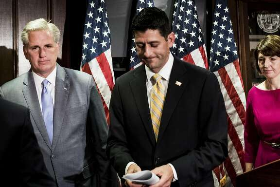 Speaker of the House Paul Ryan, center, and House Majority Leader Kevin McCarthy, left, talk to the press on Wednesday. The two attended a private Republican gathering in June 2016. At the meeting, McCarthy suggested then-candidate Donald Trump was being paid by Russian President Vladimir Putin. Must credit: Washington Post by Melina Mara