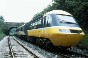 UNITED KINGDOM - JANUARY 31:  HST (high-speed train) 125 in 1985 livery passing under a bridge.  (Photo by SSPL/Getty Images)