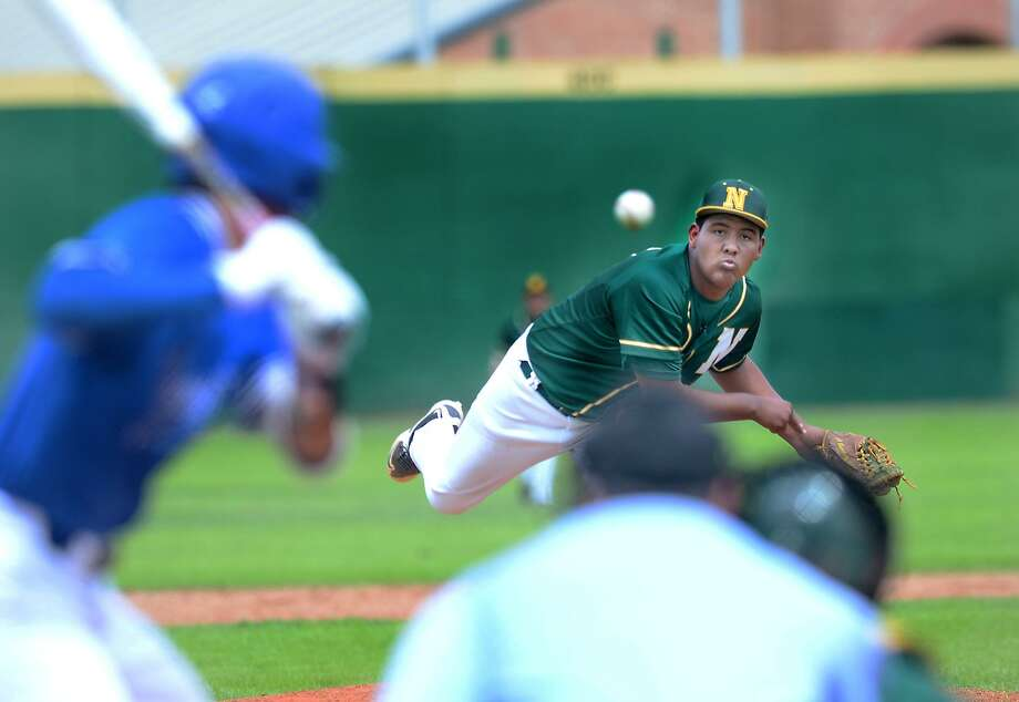 Emiliano Dominguez delivers a pitch for the Nixon Mustangs as they played the Veterans Memorial Patriots, Wednesday, March 15, 2017, at Veterans Field. Photo: Cuate Santos / Laredo Morning Times / Laredo Morning Times
