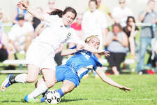THEOPHIL SYSLO | For the Daily News Midland's Makenzie Rajewski slide tackles Dow's Elizabeth Green in a game at Dow High School on Wednesday.