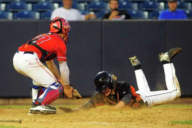 Shelton's Francis DeMarco slides into home plate but is tagged out by Fairfield Prep catcher Dan Fallacaro  during baseball action at the Ballpark at Harbor Yard in Bridgeport, Conn. on Wednesday May 17, 2017.
