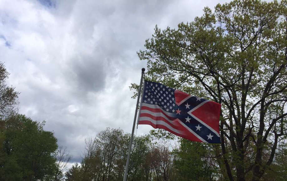 A flag that's half American and half Confederate flies a short distance from the home in Schodack where a black family was targeted by an alleged arson and racist graffiti. (Rob Gavin / Times Union)
