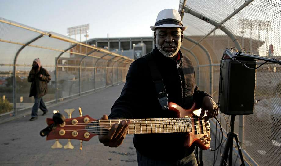 Robert Tyler, 59, of Hayward, performs on the pedestrian bridge outside of Oakland Coliseum on Thursday, April 20, 2017. Photo: Guy Wathen, The Chronicle