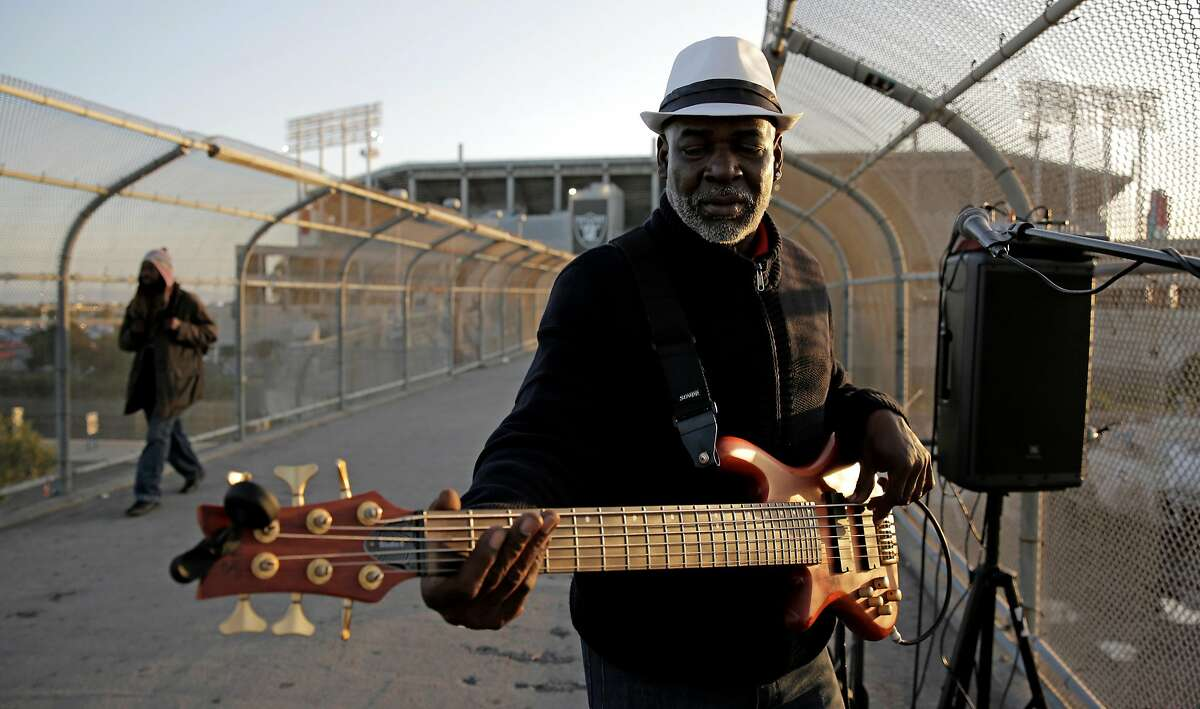 Robert Tyler, 59, of Hayward, performs on the pedestrian bridge outside of Oakland Coliseum on Thursday, April 20, 2017. For over three decades he worked on and off in the communications field but was unable to keep a steady job. �Somehow it don�t last,� says Tyler, �Always have good jobs, but they don�t last.� Now Tyler survives as a street performer and can often be found outside Bay-area sporting events.