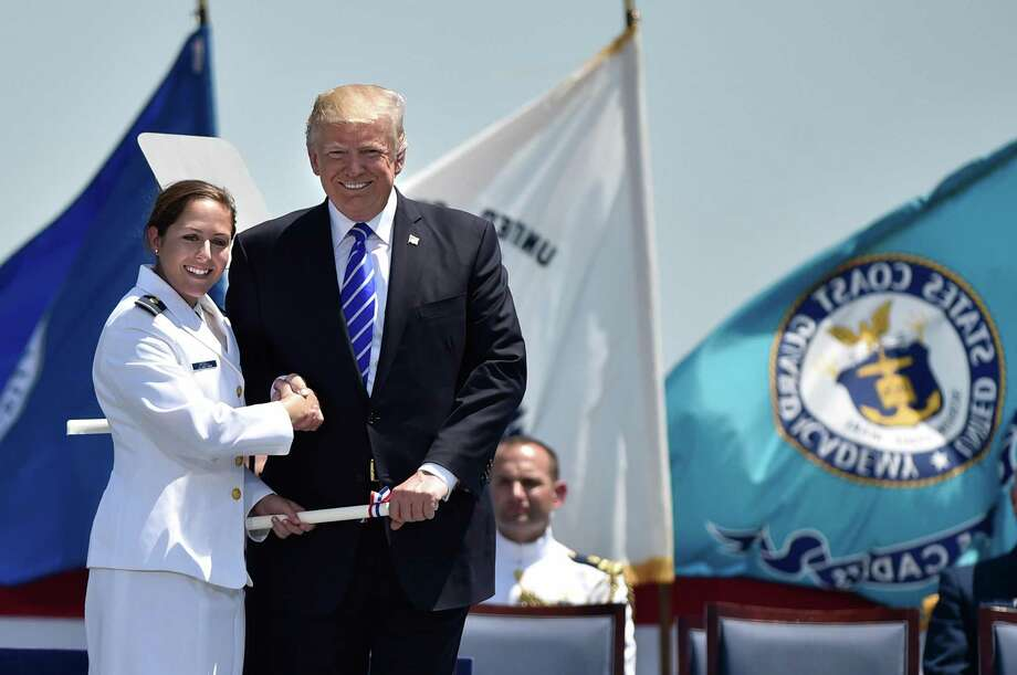 Brianna Lauren Grisell, of Brookfield, is congratulated by President Donald Trump after he awarded her commission at the United States Coast Guard Academy's 136th commencement exercises Wednesday, May 17, 2017 in New London, Conn. Photo: Cloe Poisson / Hartford Courant /TNS / Hartford Courant