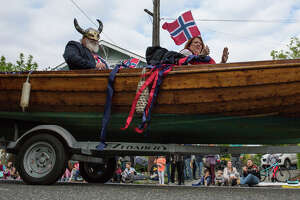 Captain Ralph Hammersborg, left, is pulled in a boat on a trailer during the Syttende Mai parade, Wednesday, May 17, 2017. The annual parade celebrates Norway's Constitution Day and Ballard's roots.