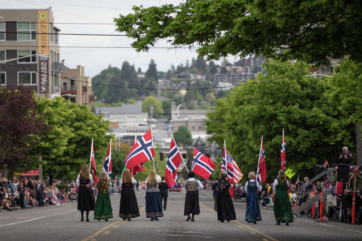 Women lead the Syttende Mai parade through Ballard.