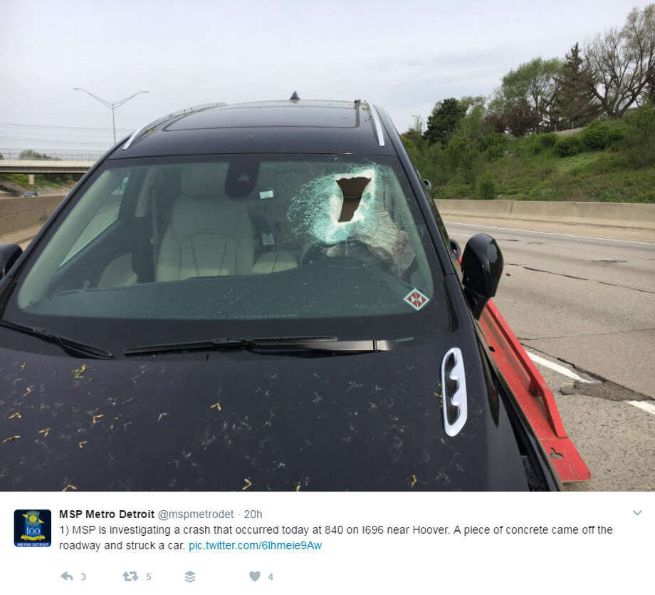 A Michigan woman is in the hospital after a football-sized piece of concrete flew through her windshield, hitting her in the head and knocking her unconscious.Photo: Michigan State Police Twitter Photo: Twitter