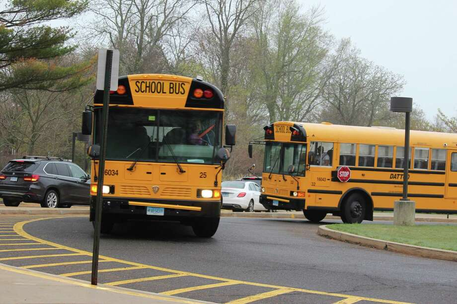 School bus drivers and their employer, Dattco, avoided a potential strike on May 18 by agreeing to a contract that runs through 2020. Photo: Chris Marquette / Hearst Connecticut Media / Westport News