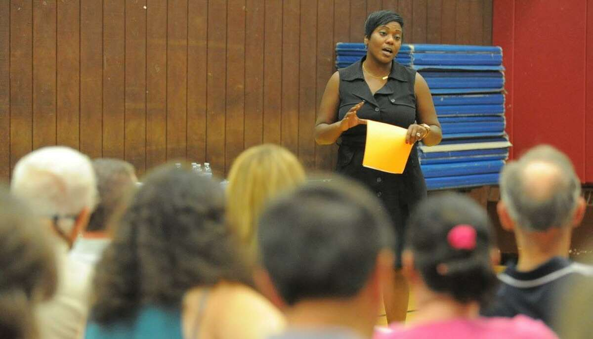 FILE - Edith Presley, Principal of Julia A. Stark School speaks about the schools D.E.A.R. (Drop Everything and Readaloud) program during the quarterly Glenbrook Neighborhood Association meeting at the Glenbrook Community Center in Stamford, Conn. on Wednesday, Sept. 21, 2016.