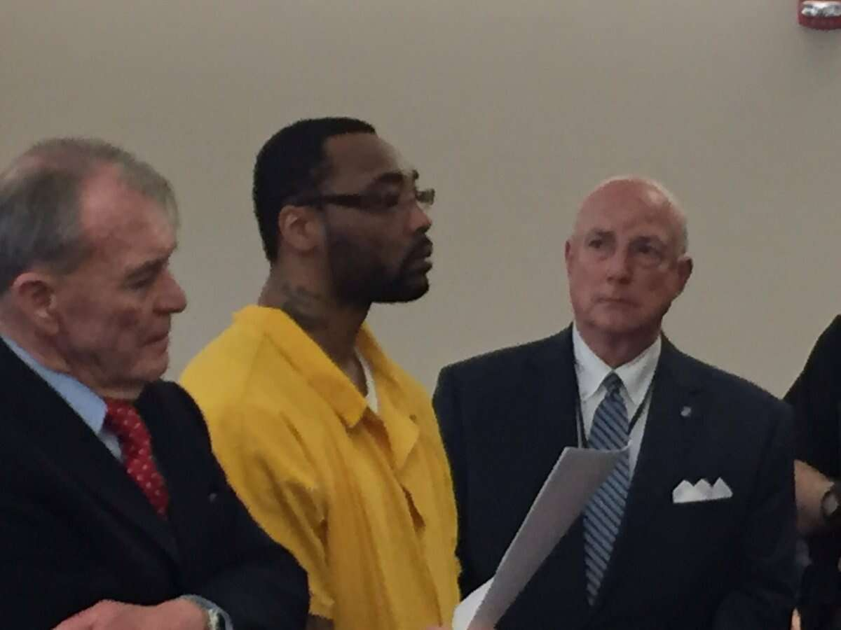 Gerard Burks stands between his lawyers, Terence Kindlon, left, and Albany County Public Defender Stephen Herrick, right, as he weighs whether to accept a plea bargain in the November death of Lori Milks, a 63-year-old city woman who was beaten to death outside an Albany apartment building.