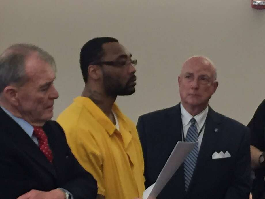 Gerard Burks stands between his lawyers, Terence Kindlon, left, and Albany County Public Defender Stephen Herrick, right, as he weighs whether to accept a plea bargain in the November death of Lori Milks, a 63-year-old city woman who was beaten to death outside an Albany apartment building. Photo: Robert Gavin / Times Union