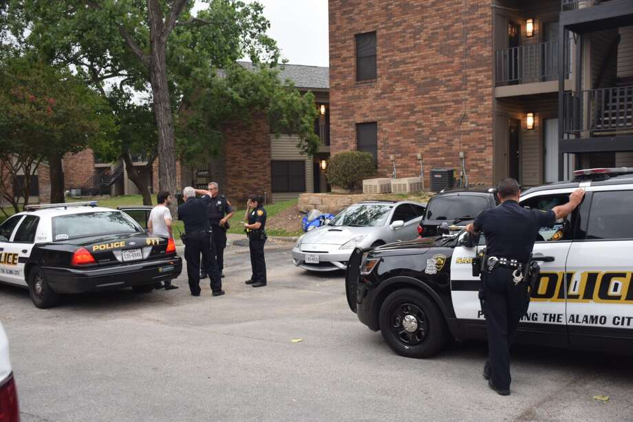Police say four victims were zip tied and robbed of their personal belongings Thursday, May 18, 2017, at an apartment complex in the Northwest Side. Photo: Caleb Downs / San Antonio Express-News