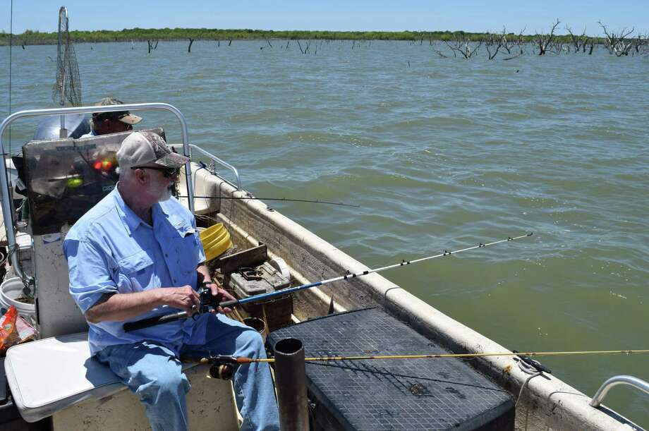 Waiting for a chance to hook a deep-water blue catfish, Harvey Winingham of Phoenix relies of the expertise of veteran guide Charlie Brown to find both blues and gaspergou at Choke Canyon. Photo: Photos By Ralph Winingham /For The Express-News