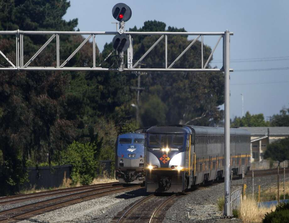 A pedestrian trespassing on the tracks in Pinole was hit and killed by an Amtrak train Thursday morning. This file photo shows two Amtrak trains passing each other in Richmond, Calif., on Wednesday, June 30, 2010. Photo: Paul Chinn, The Chronicle