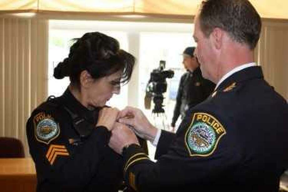 Police Chief John Lynch awards Anna Tornello with her sergeant pin at a promotion ceremony Thursday. Photo: Wilton Police Department