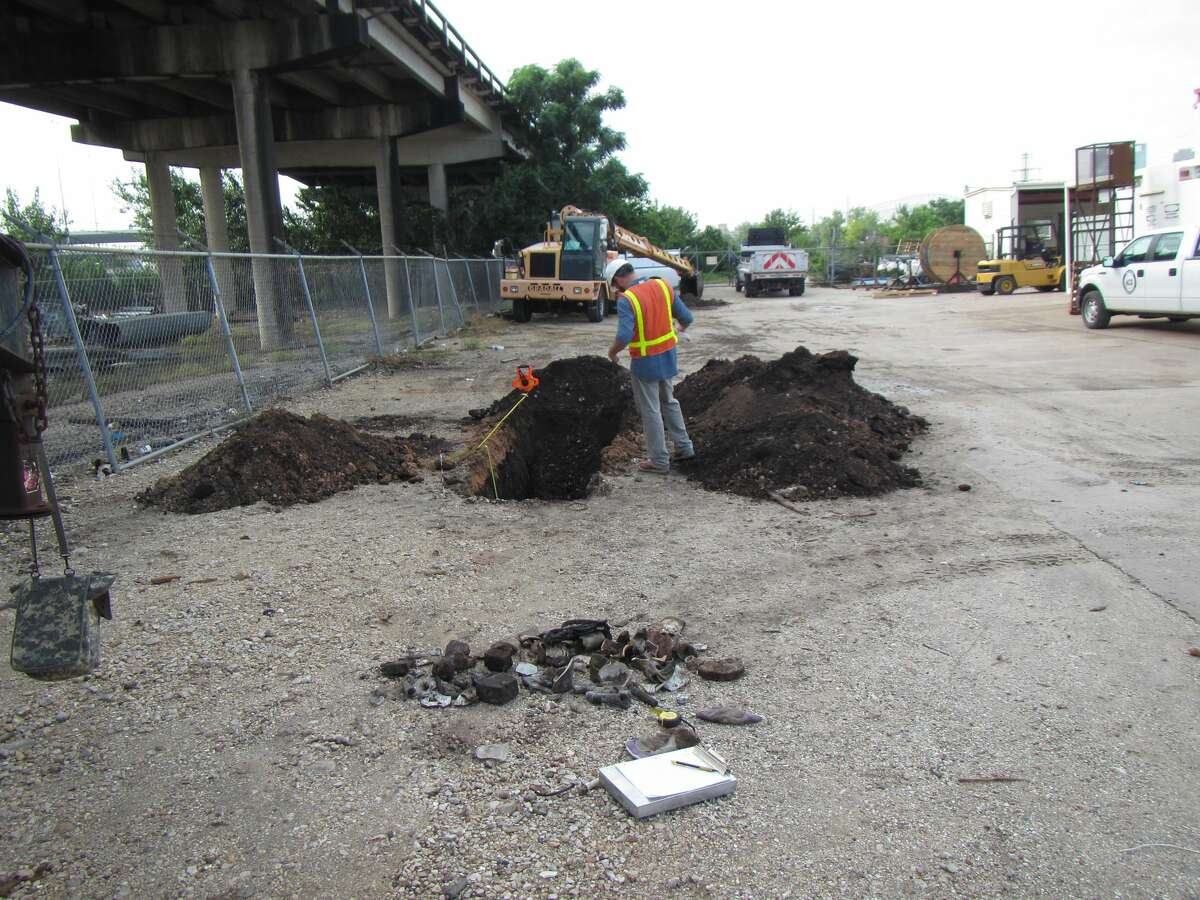 A buried and incinerated trash deposit located here near Elysian Street had been used to fill a former gully during the first half of the 20th century.